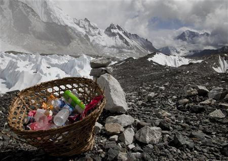 Rubbish collected at Everest base camp with the Himalayan range seen at the background in Nepal