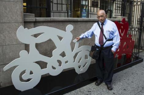 Mexican artist Aceves Navarro poses for a portrait with two of his bicycle sculptures in New York