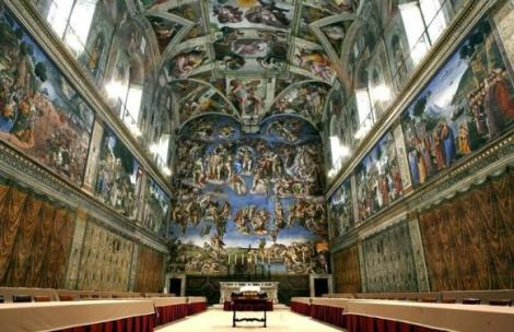 Newly installed tables stand under Michaelangelo's frescoes in the Vatican's Sistine Chapel before n..