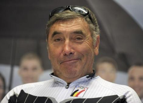 File photo of Belgian five-time Tour de France and Giro d'Italia winner Eddy Merckx smiling as he prepares to cycle to London for the opening ceremony of the Olympic Games, in Brussels