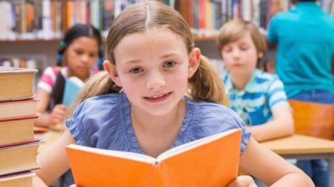 _83095641_childwithbookinlibrary